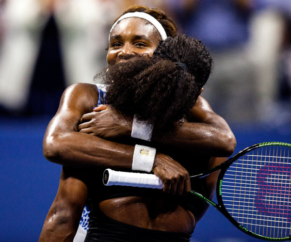 "Serena Williams, her back to the camera, with her sister Venus after Serena's victory. ""She's the toughest player I've ever played in my life,"" Serena said. Credit Sam Hodgson for The New York Times"